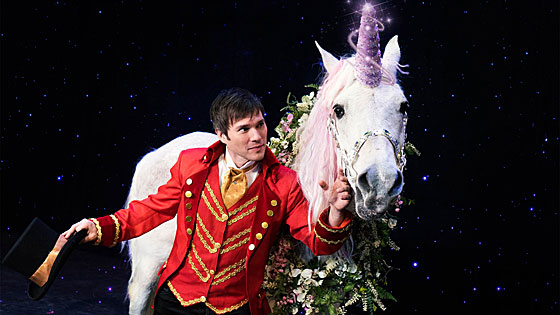 Darren Romeo plays with his magical unicorn