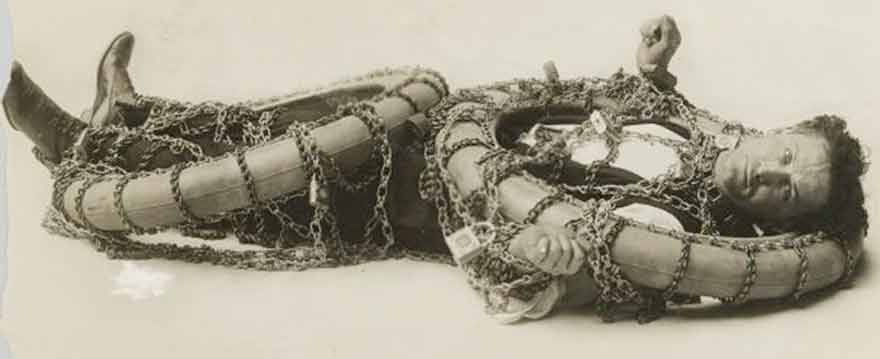 Houdini tied in chains