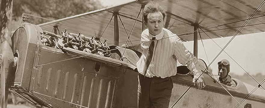 Houdini standing on the wings of a plane