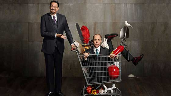 Penn and Teller show off their bad boys of magic style with Teller sitting in a shopping cart with odd and dangerous props