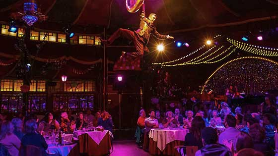 Teatro Zinzanni performs acrobatic feats of magic above your dinner table