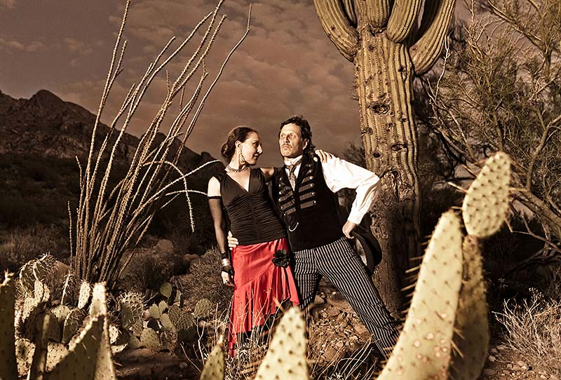 Carnival of Illusion posing in the Arizona desert at dusk with dark clouds looming
