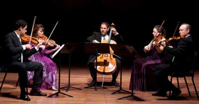 A wonderful chamber music evening with five musicians in beautiful costumes on stage.