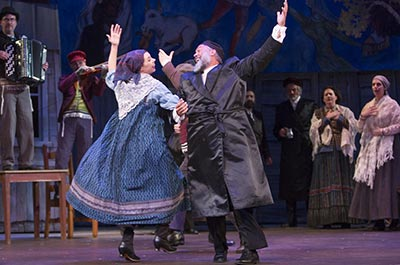Arizona Theatre Company play of Fiddler on the Roof shows two immigrants dancing merrily